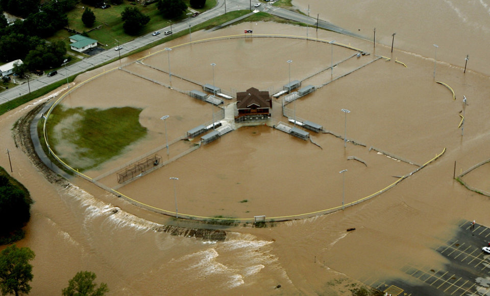 Photo - Flood water runs off of baseball fields during flooding in Seminole, Okla., Sunday, August 19, 2007. By Matt Strasen, The Oklahoman/KWTV SKYNEWS 9