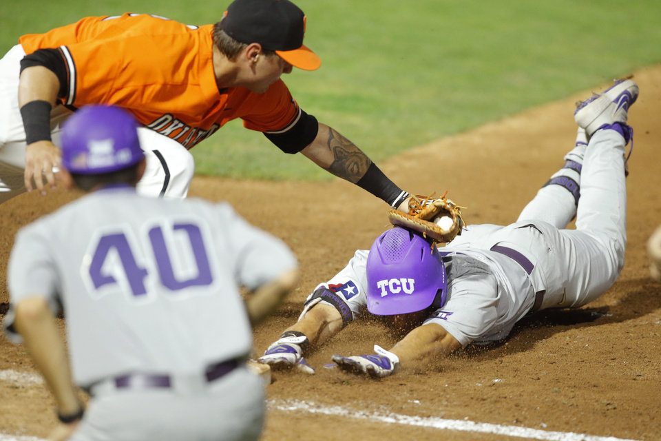 Photo - Oklahoma State's Alix Garcia (42) picks of TCU's Johnny Rizer (4) at first in the seventh inning of a Big 12 baseball tournament game between Oklahoma State University (OSU) and TCU at Chickasaw Bricktown Ballpark in Oklahoma City, Okla., Wednesday, May 22, 2019.  [Bryan Terry/The Oklahoman]