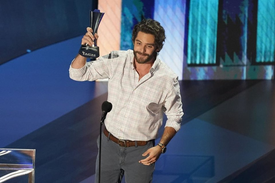 Photo - Thomas Rhett accepts the entertainer of the year award in a tie with Carrie Underwood during the 55th annual Academy of Country Music Awards at the Grand Ole Opry House on Wednesday, Sept. 16, 2020, in Nashville, Tenn. [AP Photo/Mark Humphrey]