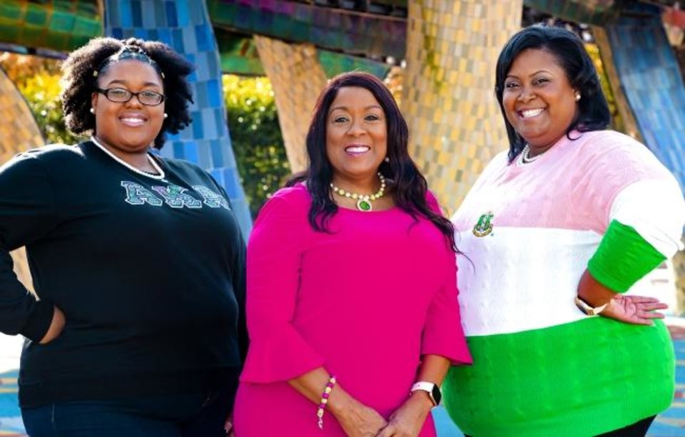 Photo -  Wearing their Alpha Kappa Alpha (AKA) Black Greek sorority pink and green sorority apparel, Tianna Carter, Karen Carter and Christina Kirk pose for a photo at the Myriad Botanical Gardens in Oklahoma City. Chris Landsberger/The Oklahoman]
