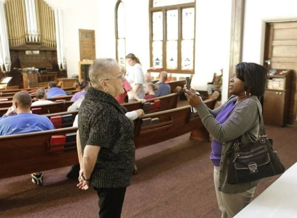 Photo -  In this 2014 photo, the Rev. Claudia Lovelace is interviewed by The Oklahoman's Religion Editor Carla Hinton at the