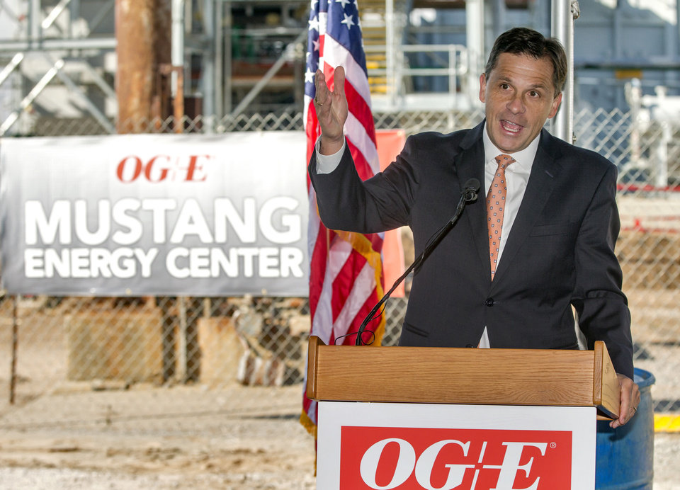 Photo -  OG&E CEO Sean Trauschke speaks during the utility's dedication of new natural gas-fired power generators at the Mustang Energy Center in western Oklahoma City. [Photo by Chris Landsberger, The Oklahoman]