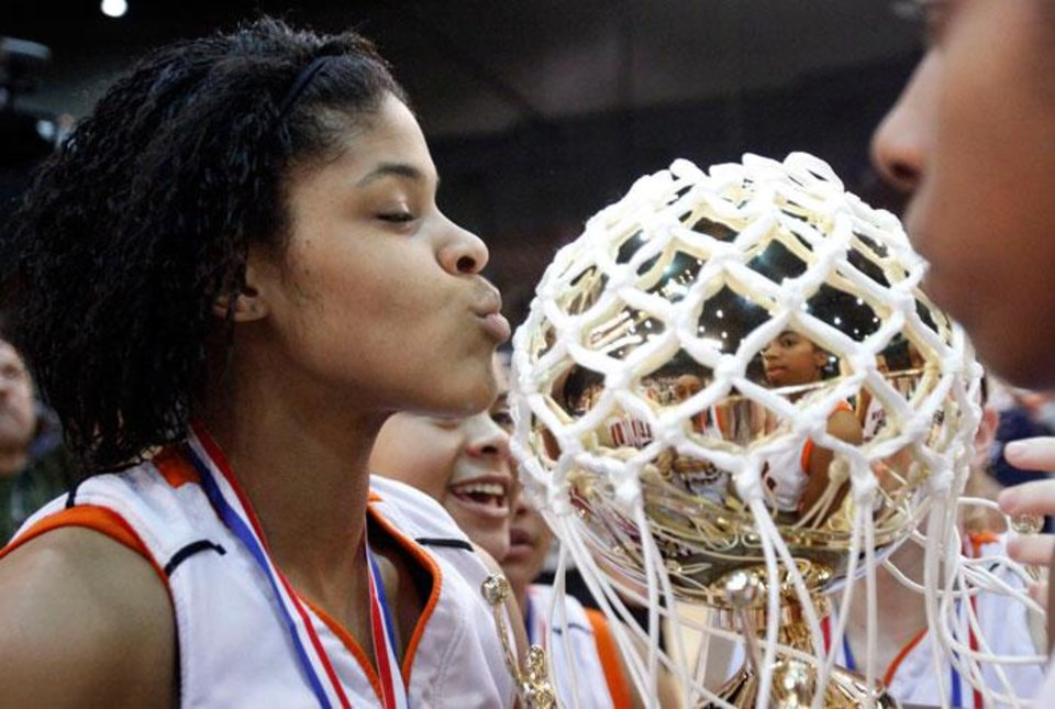 Photo -  Preston's Maylisa Johnson kisses the championship trophy following the girls Class A State Basketball finals between Preston and Crowder, Saturday, March 7, 2009, at the State Fair Arena in Oklahoma City . PHOTO BY SARAH PHIPPS, THE OKLAHOMAN