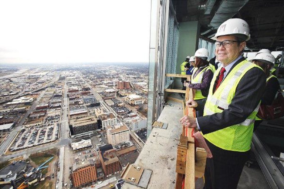 Photo - Devon Energy executive chairman Larry Nichols looking at the skyline from the 40th floor of the Devon tower under construction in downtown Oklahoma City Monday, Dec. 19, 2011. Photo by Paul B. Southerland, The Oklahoman ORG XMIT: KOD
