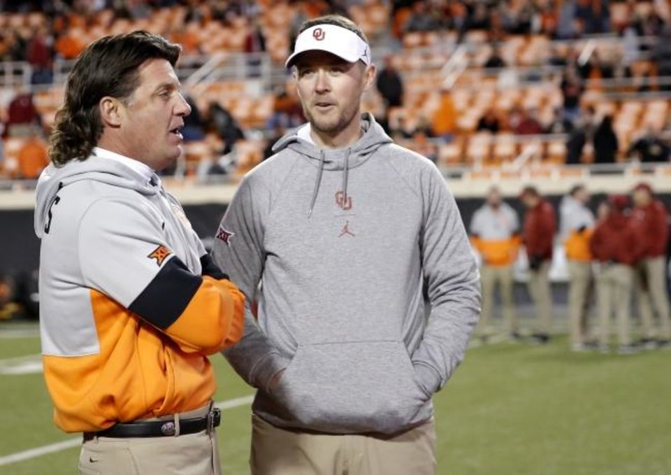 Photo -  Oklahoma State head coach Mike Gundy and Oklahoma head coach Lincoln Riley talk before the Bedlam college football game in Stillwater on Nov. 30, 2019. OU won 34-16. [Sarah Phipps/The Oklahoman]