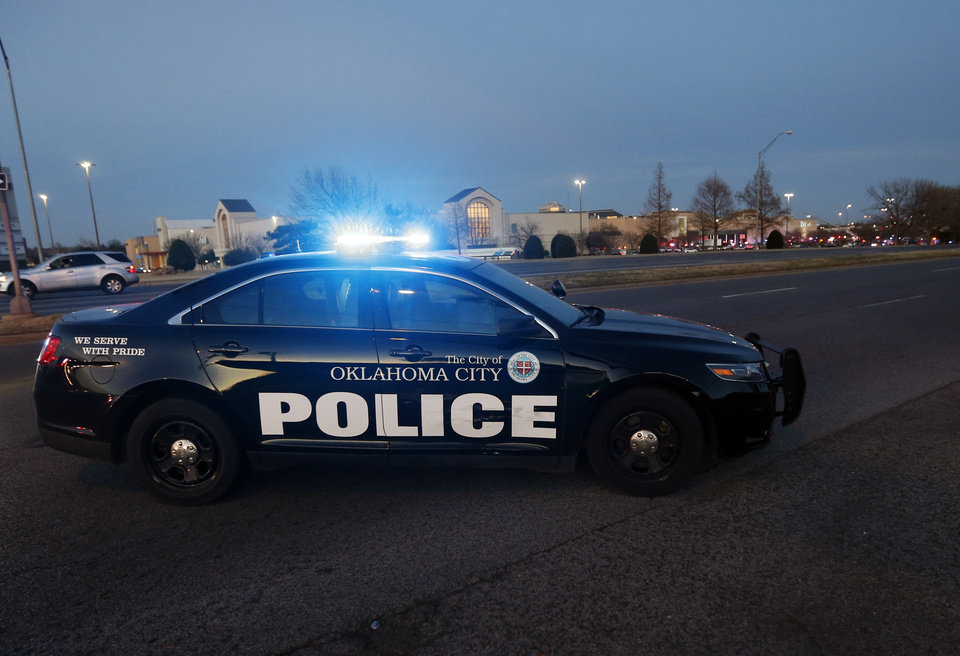 Photo - Oklahoma City Police block Northwest Expressway at Penn Ave. after a shooting at Penn Square Mall in Oklahoma City, Thursday, Dec. 19, 2019. [Nate Billings/The Oklahoman]