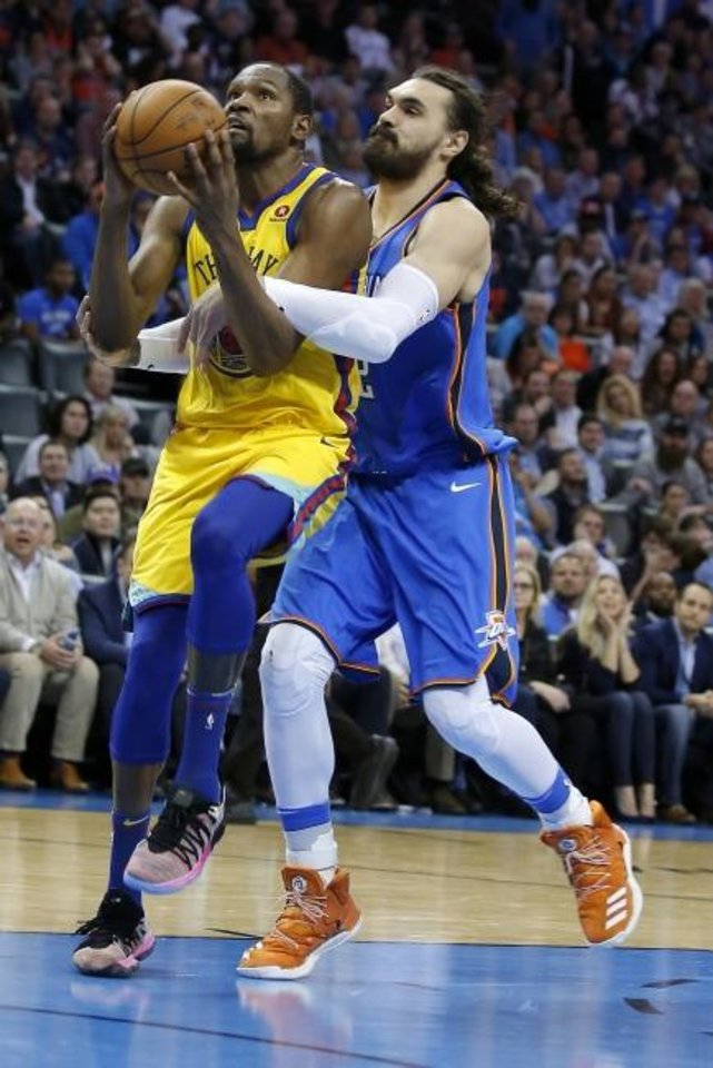 Photo -  Steven Adams fouls Golden State's Kevin Durant during a game in April 2018. [Sarah Phipps/The Oklahoman]