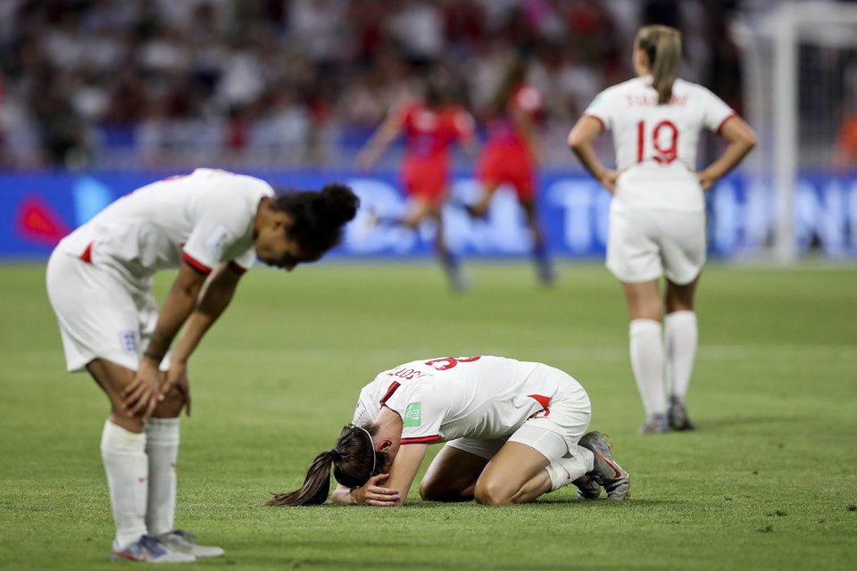 Photo - England's Jill Scott, center, reacts after losing the Women's World Cup semifinal soccer match against United States at the Stade de Lyon outside Lyon, France, Tuesday, July 2, 2019. (AP Photo/Francisco Seco)