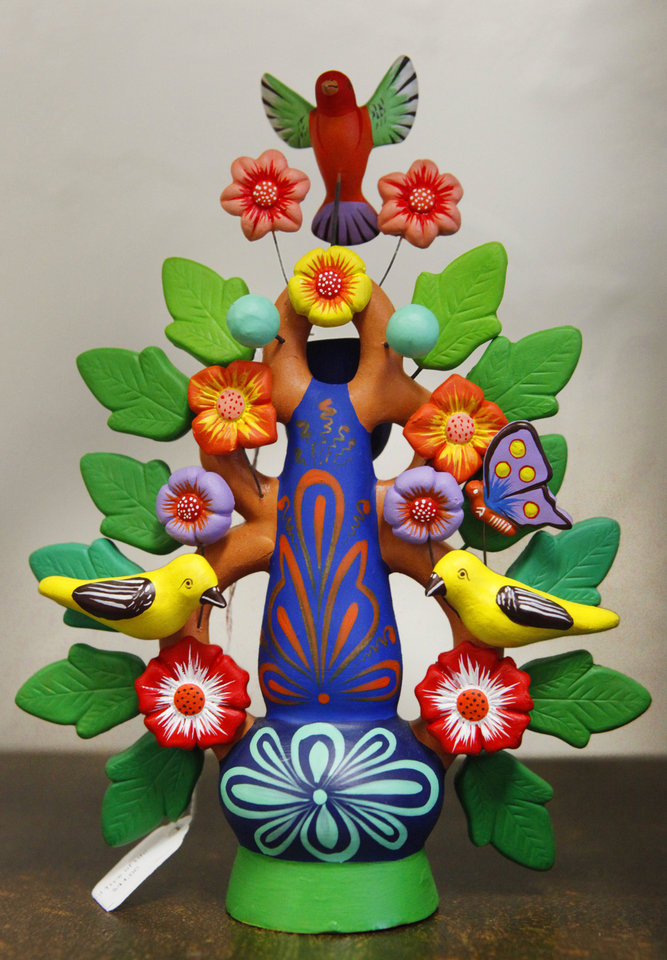 Photo - This Tree of Life sculpture from Peru is one of the items for sale at  Pambe Ghana Global Market. Photo By David McDaniel, The Oklahoman.  David McDaniel - The Oklahoman