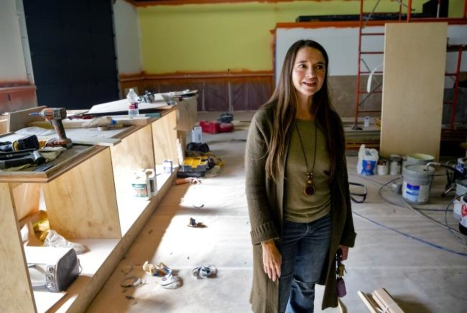 Photo -  Jamie Zumwalt tours the new Joe's Addiction coffee shop location at 1725 SE 59. [Chris Landsberger/The Oklahoman]