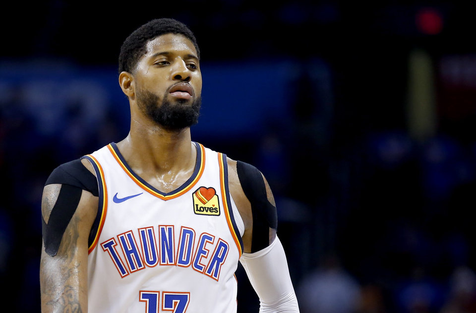 Photo - Oklahoma City's Paul George (13) walks off the court in the fourth quarter during Game 4 in the first round of the NBA playoffs between the Portland Trail Blazers and the Oklahoma City Thunder at Chesapeake Energy Arena in Oklahoma City, Sunday, April 21, 2019.  Photo by Sarah Phipps, The Oklahoman