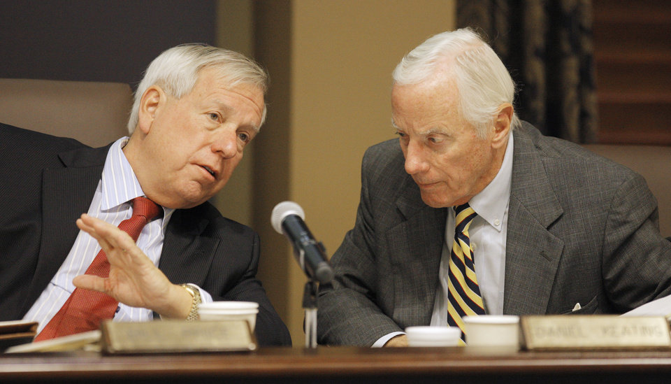 Photo -  State Education Board members Bill Price and Daniel Keating confer Thursday during the meeting.    PAUL B. SOUTHERLAND -  PAUL B. SOUTHERLAND