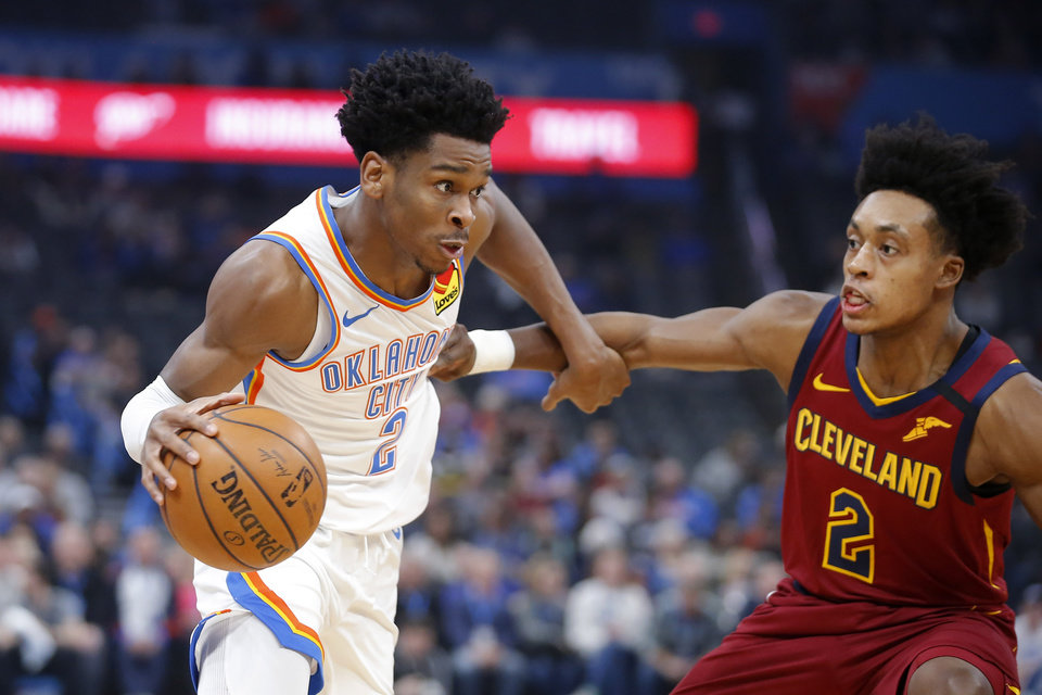 Photo - Oklahoma City's Shai Gilgeous-Alexander (2) goes past Cleveland's Collin Sexton (2) during an NBA basketball game between the Oklahoma City Thunder and the Cleveland Cavaliers at Chesapeake Energy Arena in Oklahoma City, Wednesday, Feb. 5, 2020. [Bryan Terry/The Oklahoman]