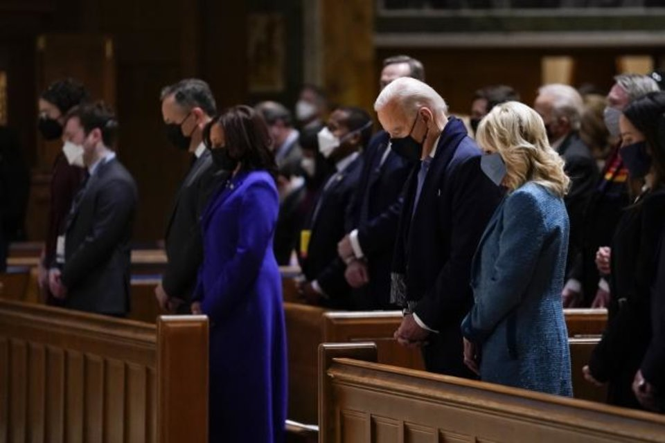 Photo -  Joe Biden and his wife, Jill Biden, attend Mass on Wednesday at St. Matthew's Cathedral during Inauguration Day ceremonies in Washington. Kamala Harris and her husband, Doug Emhoff, are at left. [AP PHOTO]