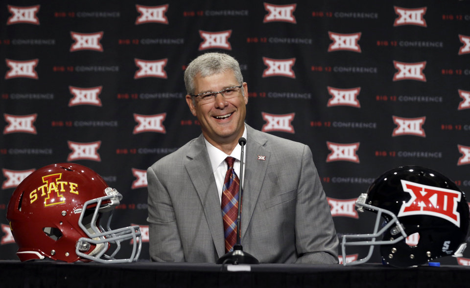 Photo - Iowa State head coach Paul Rhodes smiles as he speaks to reporters at the Big 12 Conference NCAA college football media days in Dallas, Tuesday, July 22, 2014. (AP Photo)