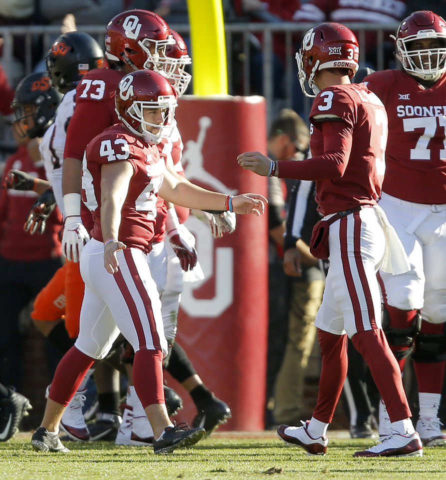 Photo - Oklahoma's Austin Seibert (43) celebrates with Connor McGinnis (3) after kicking a field goal during a Bedlam college football game between the University of Oklahoma Sooners (OU) and the Oklahoma State University Cowboys (OSU) at Gaylord Family-Oklahoma Memorial Stadium in Norman, Okla., Nov. 10, 2018.  Photo by Bryan Terry, The Oklahoman
