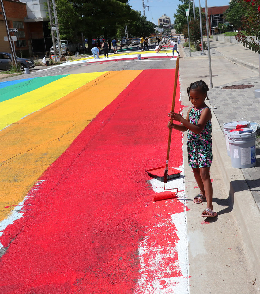 Photo - People work to paint portions of Shartel Ave., next to the Oklahoma City Police Headquarters, Tuesday, June 23, 2020. [Doug Hoke/The Oklahoman]