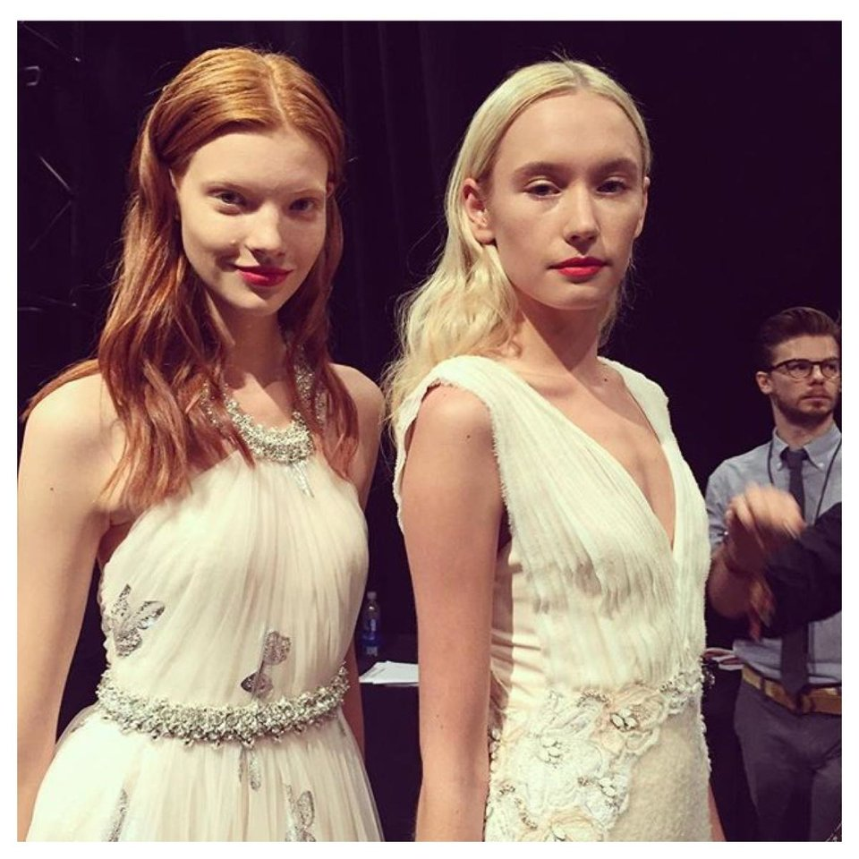 Photo - Two Badgley Mischka models dressed with hair and makeup done.