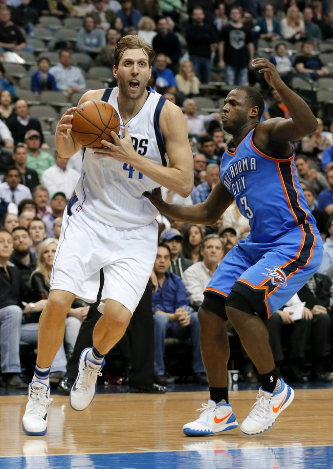 Photo - Dallas Mavericks' Dirk Nowitzki of Germany steps to the basket for a shot opportunity after getting past Oklahoma City Thunder's Dion Waiters (3) in the second half of an NBA basketball game, Wednesday, Feb. 24, 2016, in Dallas. Nowitzki lead all scoring with 33 points in the 116-103 loss to the Thunder. (AP Photo/Tony Gutierrez)