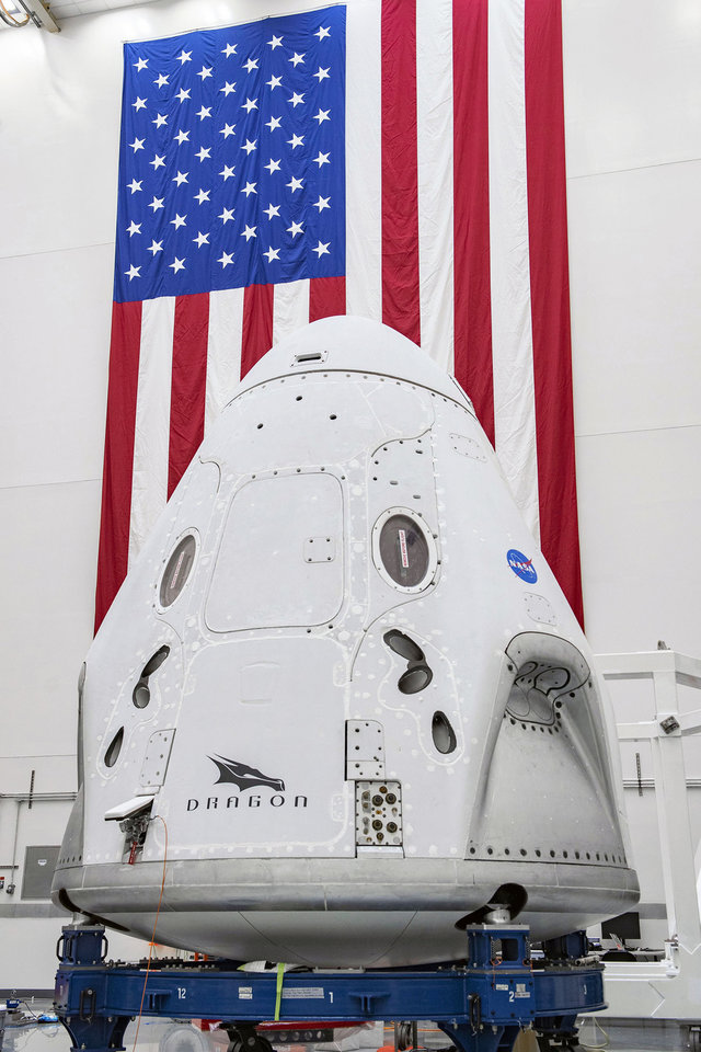 Photo -  In this April 10, 2020 photo made available by SpaceX, The SpaceX Crew Dragon spacecraft undergoes final processing at Cape Canaveral Air Force Station, Fla, in preparation for the Demo-2 launch with NASA astronauts Bob Behnken and Doug Hurley to the International Space Station for NASA's Commercial Crew Program. Crew Dragon will carry Behnken and Hurley atop a Falcon 9 rocket, returning crew launches to the space station from U.S. soil for the first time since the Space Shuttle Program ended in 2011. (SpaceX via AP)