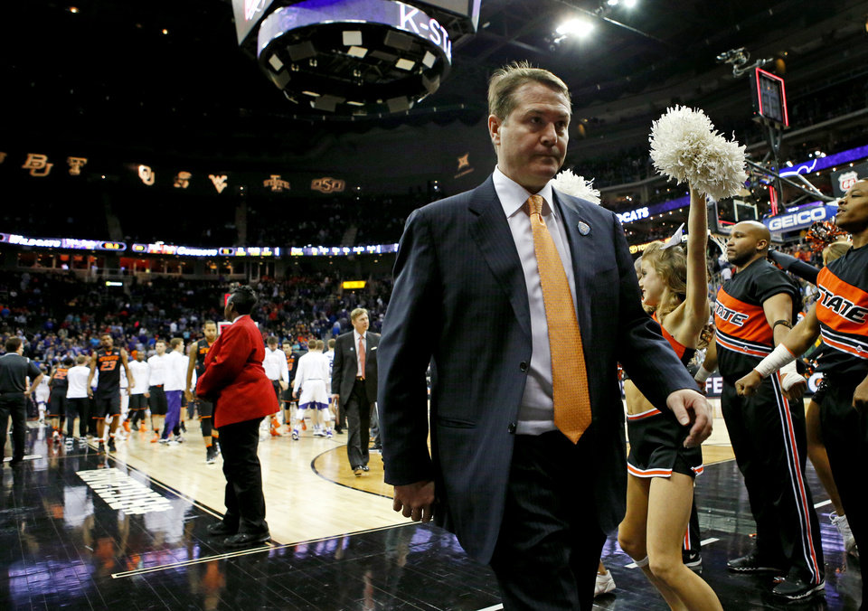 Photo - Oklahoma State coach Travis Ford walks off the court after a Big 12 Tournament basketball game between Oklahoma State University (OSU) and Kansas State at the Sprint Center in Kansas City, Mo., Wednesday, March 9, 2016. Oklahoma State lost 75-71. Photo by Bryan Terry, The Oklahoman