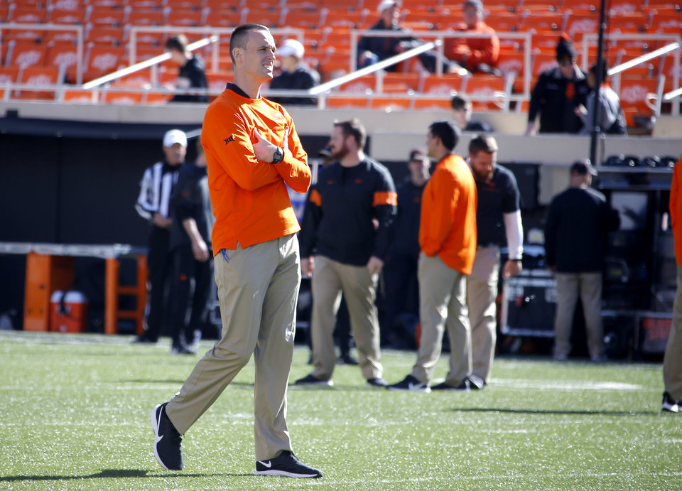 Photo - Oklahoma State's Sean Gleeson, Offensive Coordinator/Quarterbacks, watches warm ups before the college football game between the Oklahoma State University Cowboys and the TCU Horned Frogs at Boone Pickens Stadium in Stillwater, Okla.,  Saturday, Nov. 2, 2019. [Sarah Phipps/The Oklahoman]