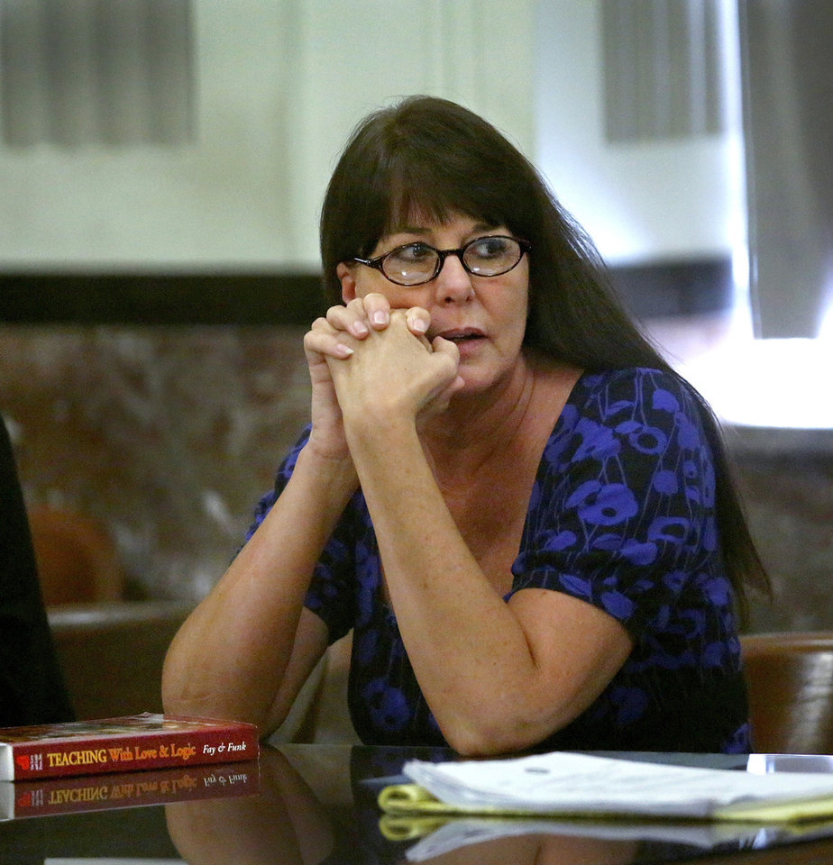 Photo - Lisa Kays, a former Putnam City High School Spanish teacher, received a 4-year sentance Monday after pleading guilty to charges of having sex with a male student who was 17 at the time. PHOTO BY JIM BECKEL, THE OKLAHOMAN  Jim Beckel - THE OKLAHOMAN