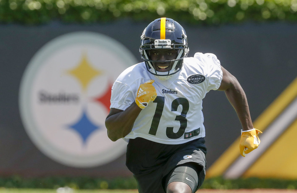 Photo - Pittsburgh Steelers wide receiver James Washington (13) performs drills during an NFL football practice at the team's training facility, Wednesday, June 12, 2019, in Pittsburgh. (AP Photo/Keith Srakocic)