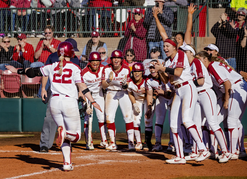 Photo - Oklahoma celebrates as Lynnsie Elam (22) scores on a home run during the college softball game between the University of Oklahoma Sooners (OU) and Northwester University Wildcats (NU) at Marita Hynes Field in Norman, Okla. on Friday, Feb. 28, 2020.    [Chris Landsberger/The Oklahoman]