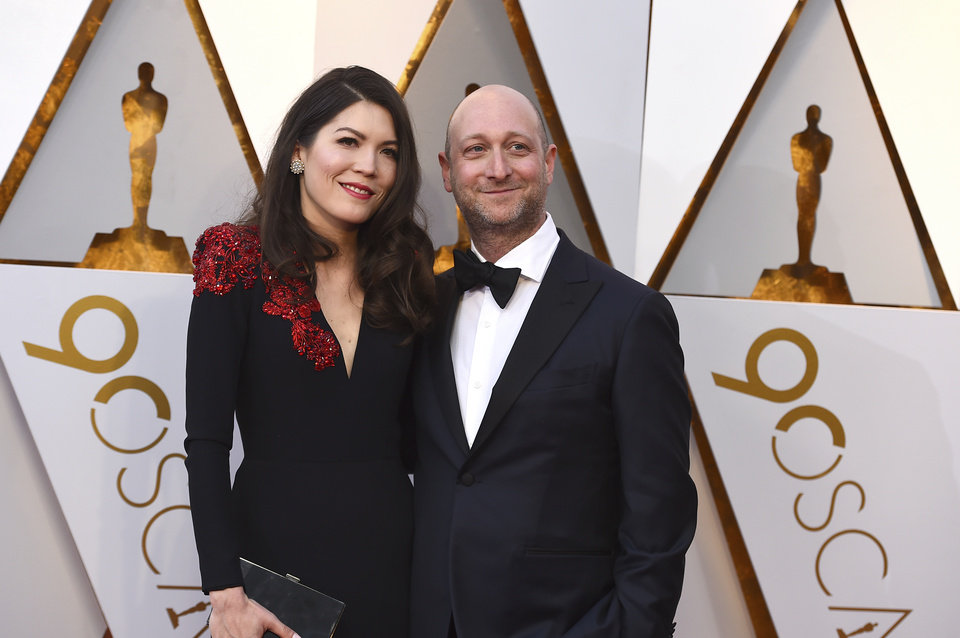 Photo - Amber Green, left, and Michael Green arrive at the Oscars on Sunday, March 4, 2018, at the Dolby Theatre in Los Angeles. (Photo by Jordan Strauss/Invision/AP)