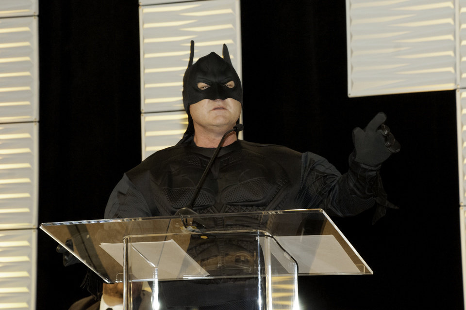Photo - Dressed as Batman, broadcast journalist Ed Murray serves as emcee for the Whiz Kids Oklahoma