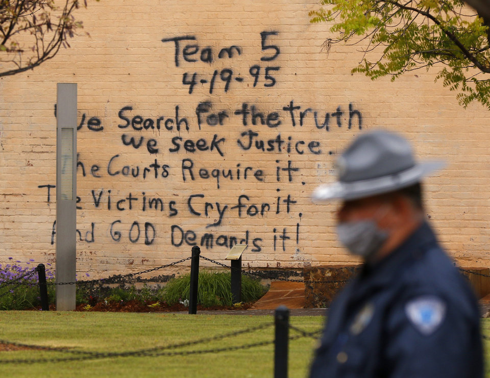 Photo - Search and rescue team 5's spray painted message from the day of the bombing on a wall of the Journal Record Building inside the Oklahoma City National Memorial and Museum on the 25th anniversary of the bombing of the Alfred P. Murrah Federal Building, in Oklahoma City, Sunday, April 19, 2020. The memorial remains closed and did not hold a live remembrance ceremony because of the coronavirus pandemic. [Doug Hoke/The Oklahoman]