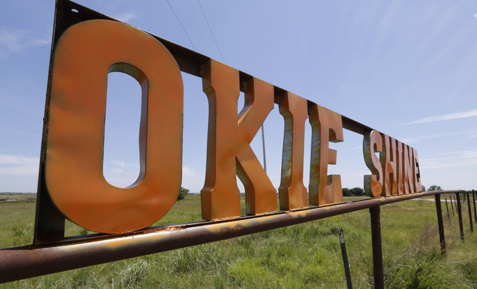 Photo -  A sign outside the Okie Shine distillery in Tuttle. [Photo by Steve Sisney, The Oklahoman]