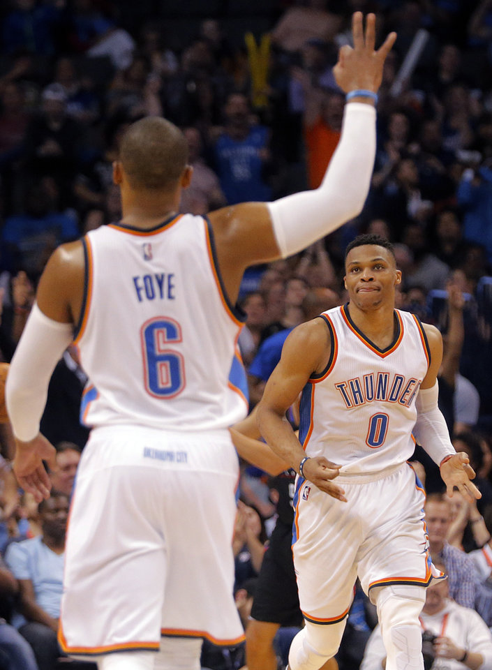 Photo - Oklahoma City's Randy Foye (6) and Russell Westbrook (0) react after a three point shot during the NBA basketball game between the Oklahoma City Thunder and the Los Angeles Clippers at Chesapeake Energy Arena on Wednesday, March 9, 2016, in Oklahoma City, Okla. Photo by Chris Landsberger, The Oklahoman