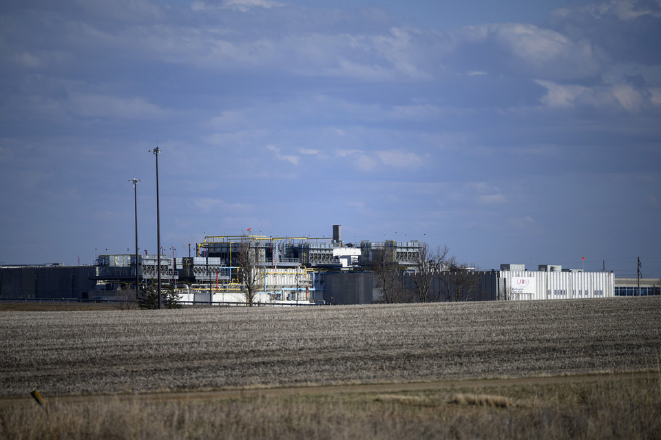 Photo -  FILE - This April 18, 2020, file photo, shows the JBS USA Pork Plant in Worthington, Minn. Federal recommendations meant to keep meatpacking workers safe as they return to plants that were shuttered by the coronavirus have little enforcement muscle behind them, fueling anxiety that working conditions could put employees' lives at risk. Major meatpackers JBS, Smithfield and Tyson have said worker safety is their highest priority. (Aaron Lavinsky/Star Tribune via AP)