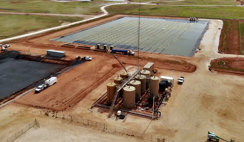 Photo -  A water recycling and disposal facility in the STACK play of the Anadarko Basin. [PROVIDED BY OVINTIV]