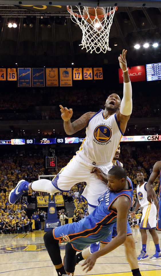 Photo - Golden State's Marreese Speights (5) is fouled by Oklahoma City's Kevin Durant (35) as he makes a lay-up in the fourth quarter during Game 5 of the Western Conference finals in the NBA playoffs between the Oklahoma City Thunder and the Golden State Warriors at Oracle Arena in Oakland, Calif., Thursday, May 26, 2016. The Warriors won 120-111. Photo by Nate Billings, The Oklahoman