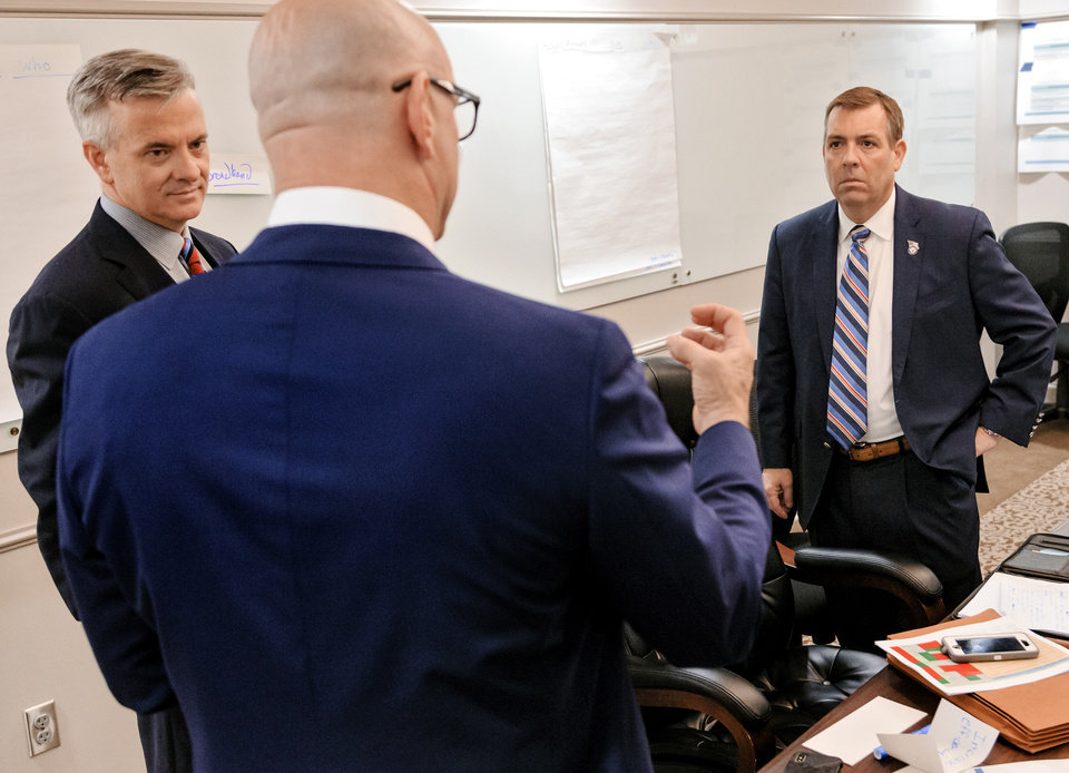 Photo -  Secretary of Digital Transformation and Administration David Ostrowe, right, talks with Secretary of Energy and Environment Kenneth Wagner and State Chief Operation Officer John Budd, left, during a cabinet strategy planning meeting last week at the Capitol in Oklahoma City. [Chris Landsberger/The Oklahoman]