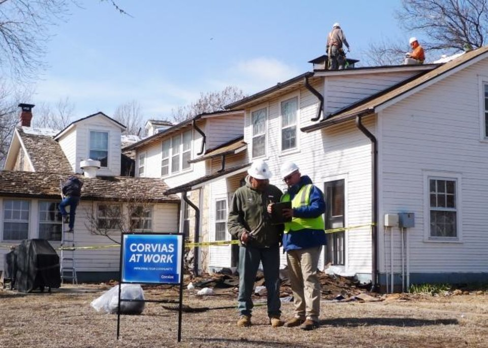 Photo -  A Corvias crew works to put  a new roof on a historic home at Fort Sill. [PHOTO PROVIDED BY CORVIAS]