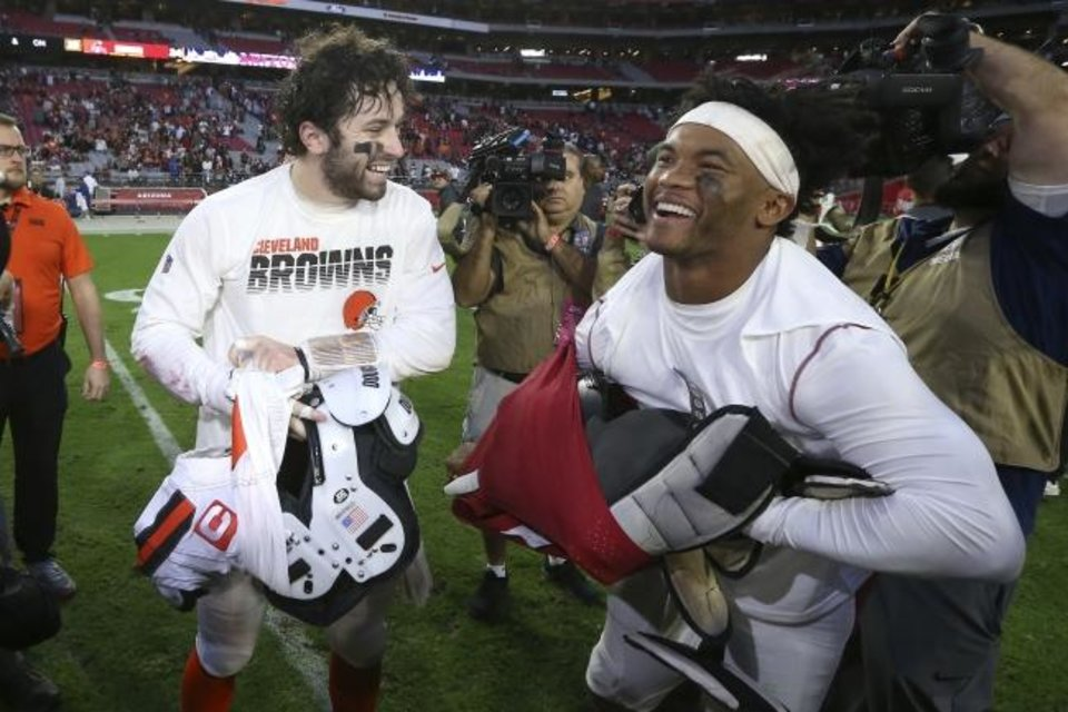 Photo -  Former OU quarterbacks Baker Mayfield, left, of the Browns and Kyler Murray of the Cardinals exchange jerseys after a game last season. [AP Photo/Ross D. Franklin]