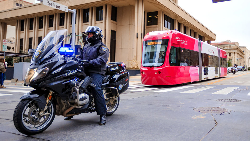 Photo - Oklahoma City Police escort the streetcar to Leadership Square to celebrate the grand opening ceremony of the Oklahoma City streetcar system in downtown Oklahoma City, Okla. on Friday, Dec. 14, 2018. Photo by Chris Landsberger, The Oklahoman