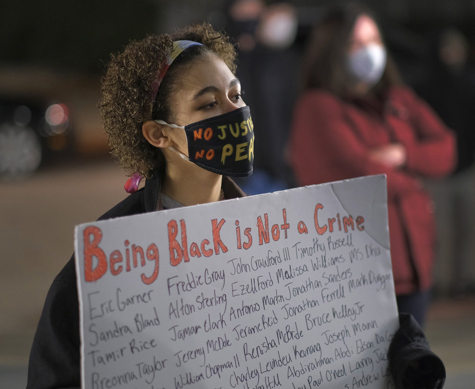 Photo - BLM holds a protest rally at the Oklahoma City Police Headquarters, then marched to the Oklahoma County Courthouse, then finally to the Oklahoma City Municipal Court Building Friday night in response to OCPD officers  shooting and killing a Black man in a northwest Oklahoma City parking lot at Penn and Hefner Friday morning, December 11, 2020. [Doug Hoke/The Oklahoman]