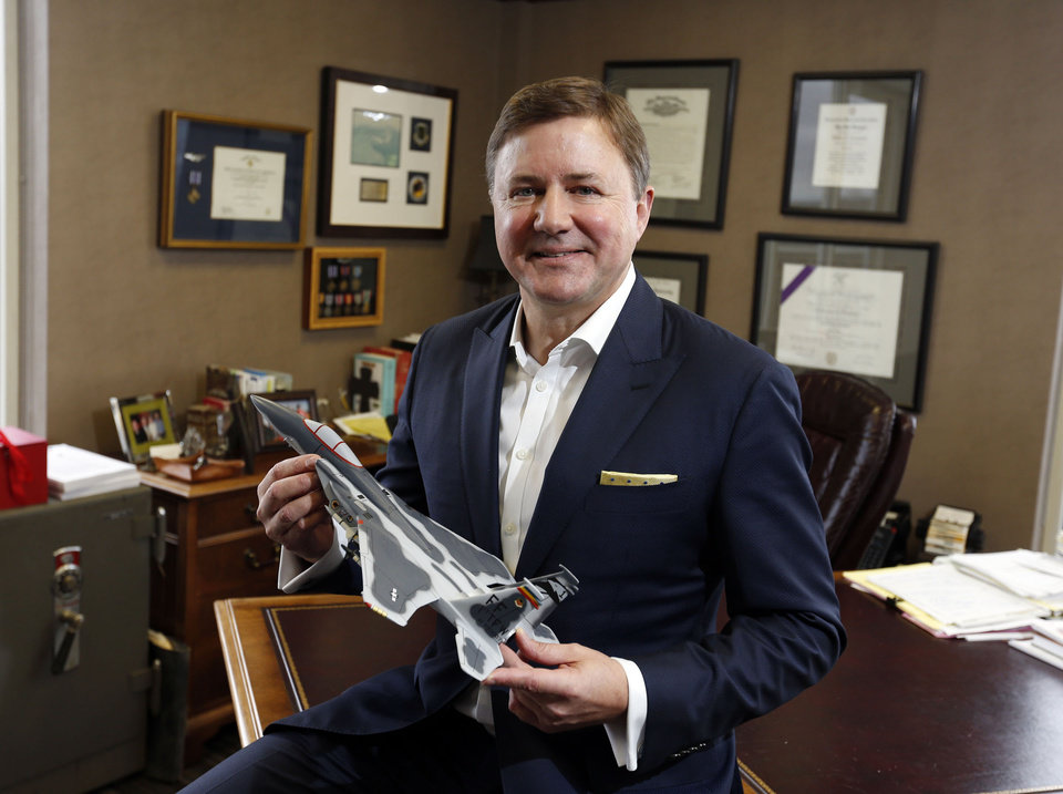 Photo - Gentner Drummond holds a model of the fighter jet he flew during the Gulf War sits in his office in Tulsa, OK, January 8, 2016. STEPHEN PINGRY/Tulsa World