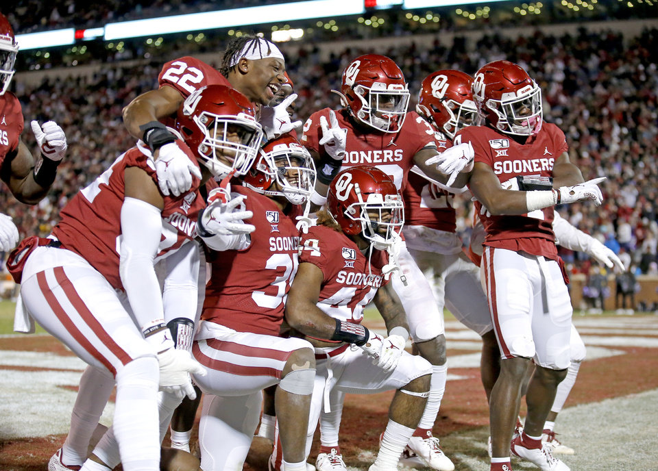 Photo - Oklahoma's Brendan Radley-Hiles (44) celebrates his interception with teammates late in the fourth quarter during an NCAA football game between the University of Oklahoma Sooners (OU) and the TCU Horned Frogs at Gaylord Family-Oklahoma Memorial Stadium in Norman, Okla., Saturday, Nov. 23, 2019. OU won 28-24. [Sarah Phipps/The Oklahoman]