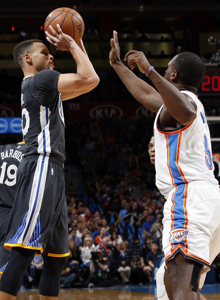 Photo - Golden State's Stephen Curry (30) shoots against Oklahoma City's Dion Waiters (3) during an NBA basketball game between the Oklahoma City Thunder and the Golden State Warriors at Chesapeake Energy Arena in Oklahoma City, Saturday, Feb. 27, 2016. Golden State won 121-118 in overtime. Photo by Nate Billings, The Oklahoman