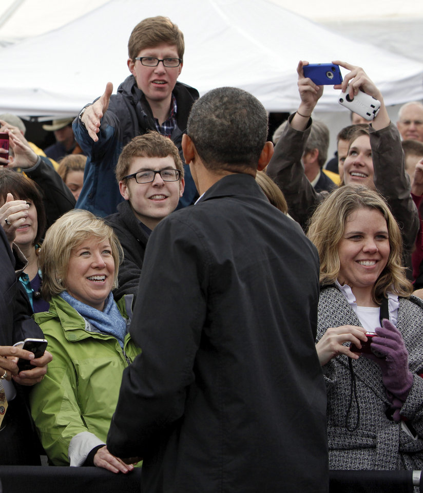 Photo - President Barack Obama shakes hands and talks with people after speaking about energy at the TransCanada Pipe Yard near Cushing, Okla., Thursday, March 22, 2012. Photo by Nate Billings, The Oklahoman