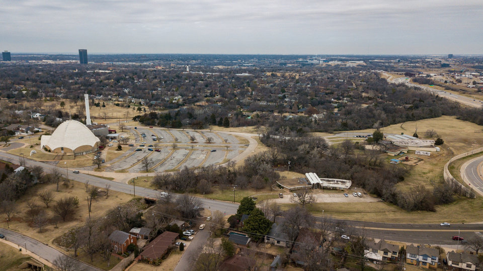 Photo -  First Christian Church, viewed from the air, is part of a 31-acre campus at NW 36 and Walker Avenue. The church is zoned for commercial development while the surrounding property is zoned for single family housing. [DAVE MORRIS/THE OKLAHOMAN]