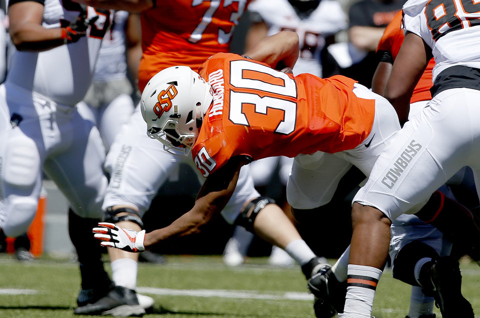 Photo - Oklahoma State's Chuba Hubbard (30) dives forward during the Oklahoma State Cowboys spring practice at Boone Pickens Stadium in Stillwater, Okla., Saturday, April 20, 2019.  Photo by Sarah Phipps, The Oklahoman