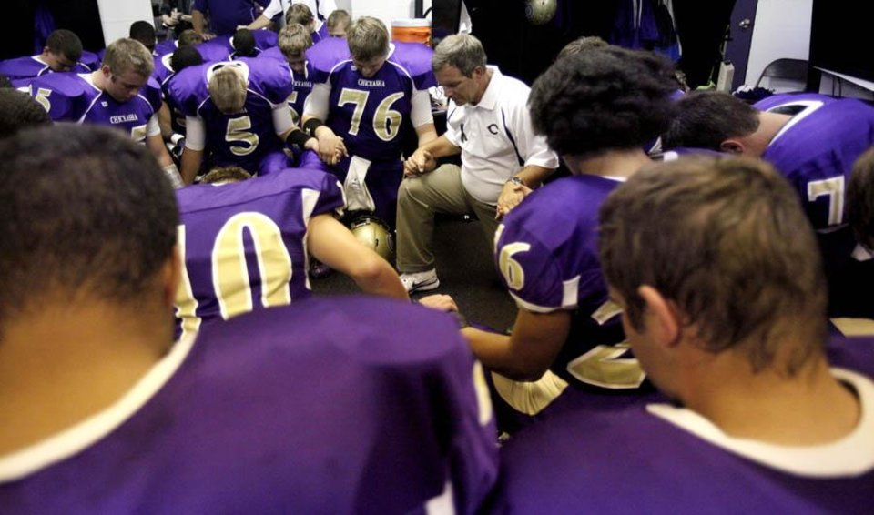 Photo -  Chickasha head coach Rick VanCleave leads the team in prayer before the football game between Chickasha and Capitol Hill at Chickasha High School, Friday, Oct. 1, 2010, at the Bethany, Okla.  It was the first home game since the death of player Kody Turner. Photo by Sarah Phipps, The Oklahoman