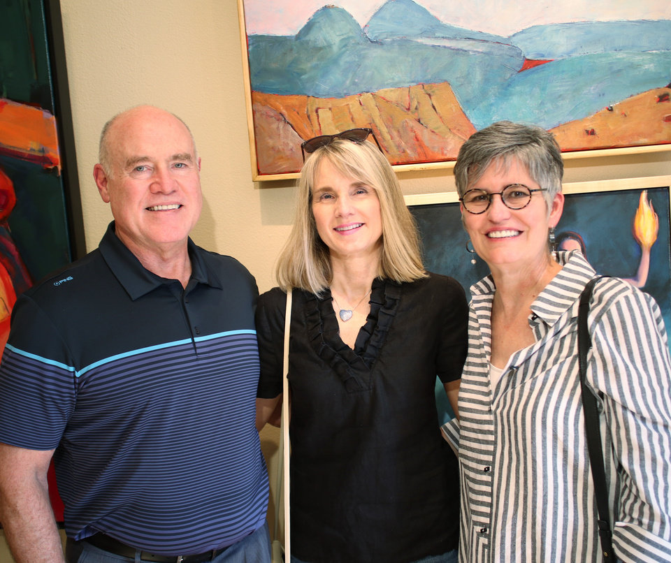 Photo - Charlie Arnold, Angela Harkey and Janice Matthews-Gordon at JRB Art at the Elms gallery during the Paseo First Friday art walk July 7, 2017. Photo by Doug Hoke.